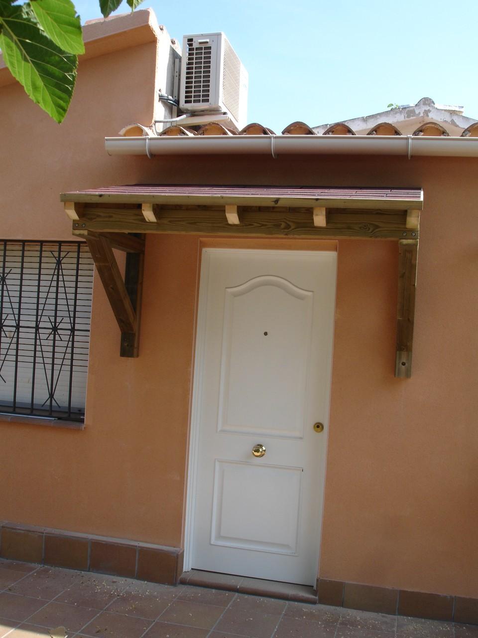 Marquesinas para puertas de entrada garaje con doble for Marquesinas para puertas